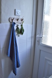 We added hooks by the door for tea towels, keys, etc.