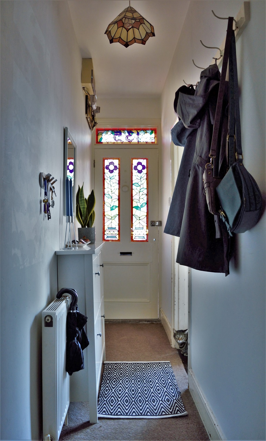 Victorian entry hallway with stained glass door