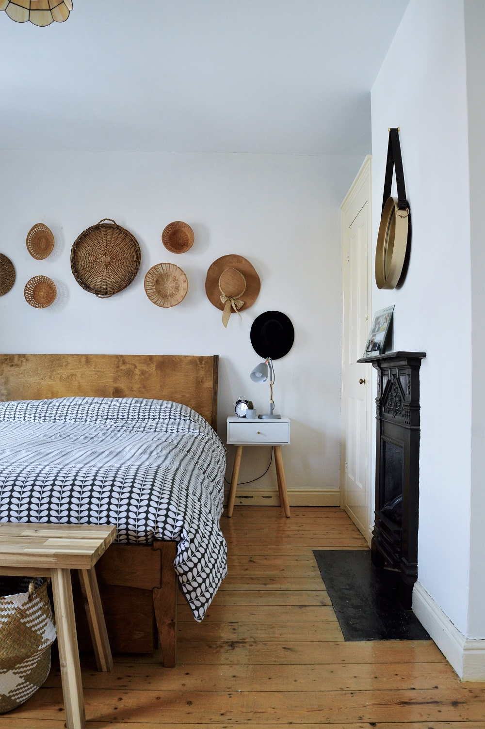 Bedroom - bed with basket gallery wall